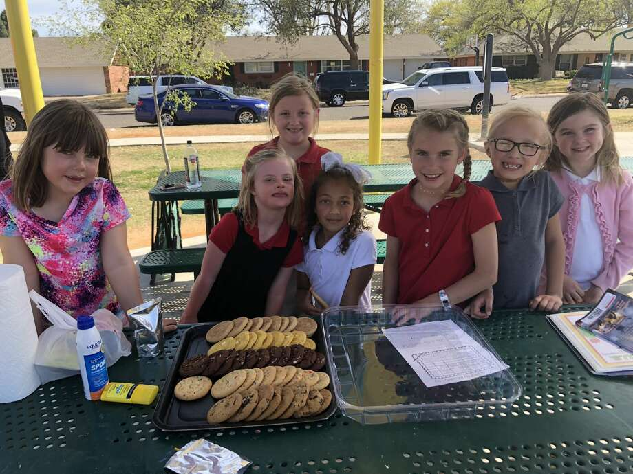 World Down Syndrome Day: Mary Carter, back, and Lindy Ham, front row from left, Emery Ham, Aubri Williams, Laney Kate Johnston, Emma Doucet and Abby McClendon Photo: Courtesy Photo
