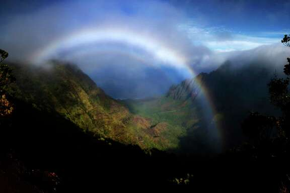 A rainbow stretches across the Napali Coast from the Pu?u O Kila Lookout Wednesday, Dec. 20, 2017 in Koke'e State Park. ( Michael Ciaglo / Houston Chronicle)