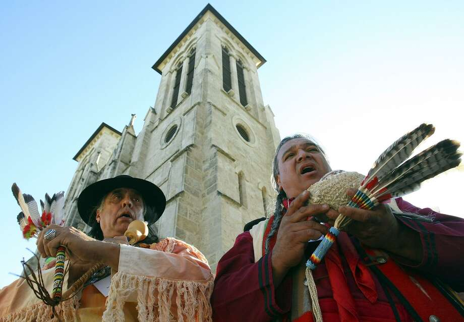 Ramon Vasquez Y Sanchez (left) and Isaac Alvarez Cardenas, members of the Tap Pilam Coahuiltecan Nation, take part in an indigenous blessing in 2008 in Main Plaza. (PHOTO BY EDWARD A. ORNELAS/STAFF) Photo: EDWARD A. ORNELAS /SAN ANTONIO EXPRESS-NEWS / SAN ANTONIO EXPRESS-NEWS