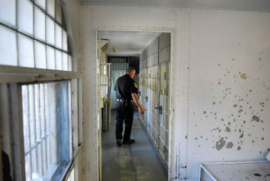 Greene County Jail Superintendent Mike Spitz looks over the third floor jail cells on Tuesday, April 24, 2018, in Catskill, N.Y. Sheriff Gregory Seeley shut down his jail late last week, sending all of his prisoners to neighboring county jail because of the decaying state of the structure. The sheriff and Greene County are at odds over details of a new jail. (Will Waldron/Times Union) Photo: Will Waldron, Albany Times Union / 20043435A