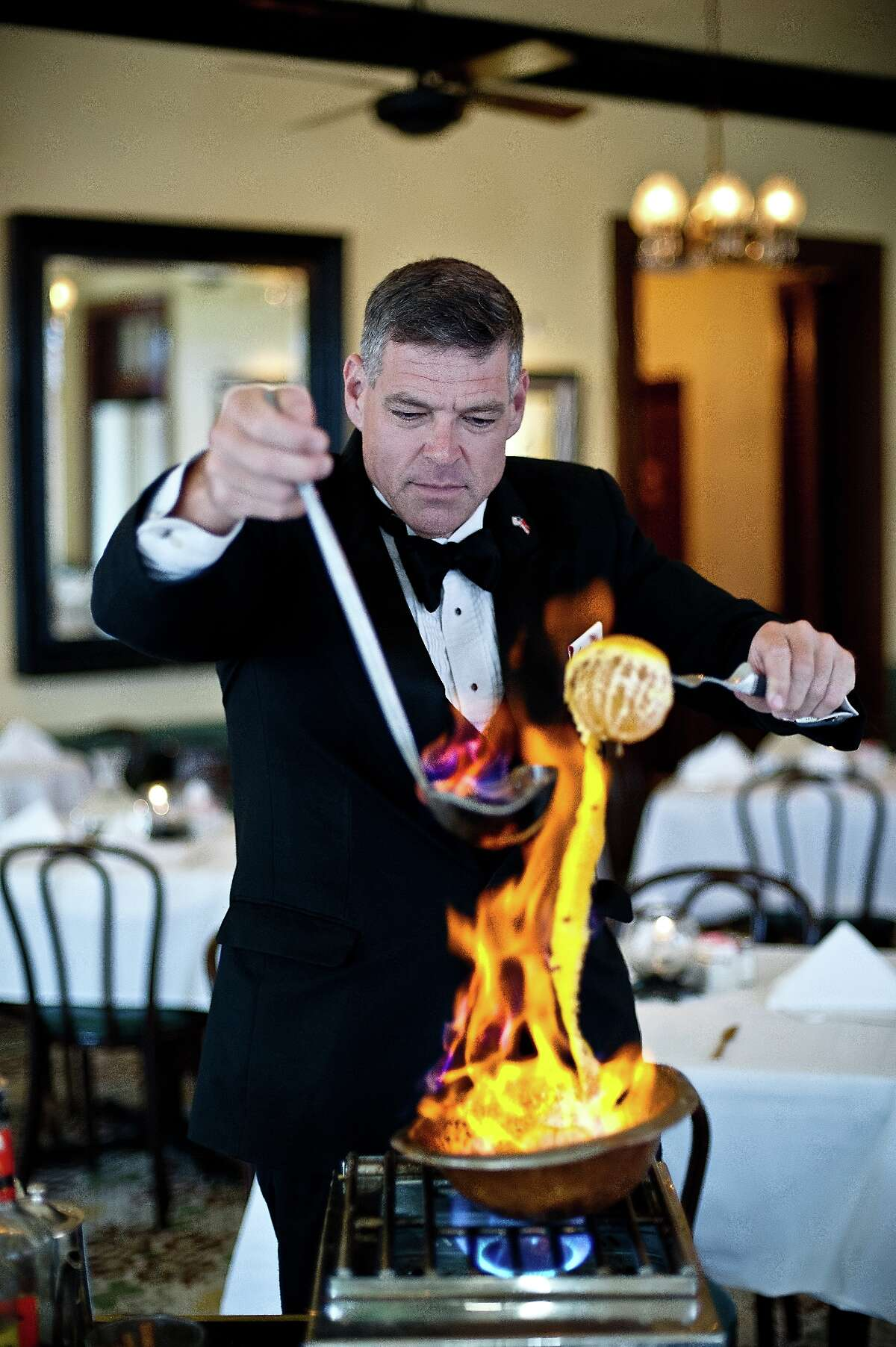 Preparing cafe brulot tableside is a tradition at Arnaud's Restaurant, New Orleans, marking its 100th anniversary in 2018.