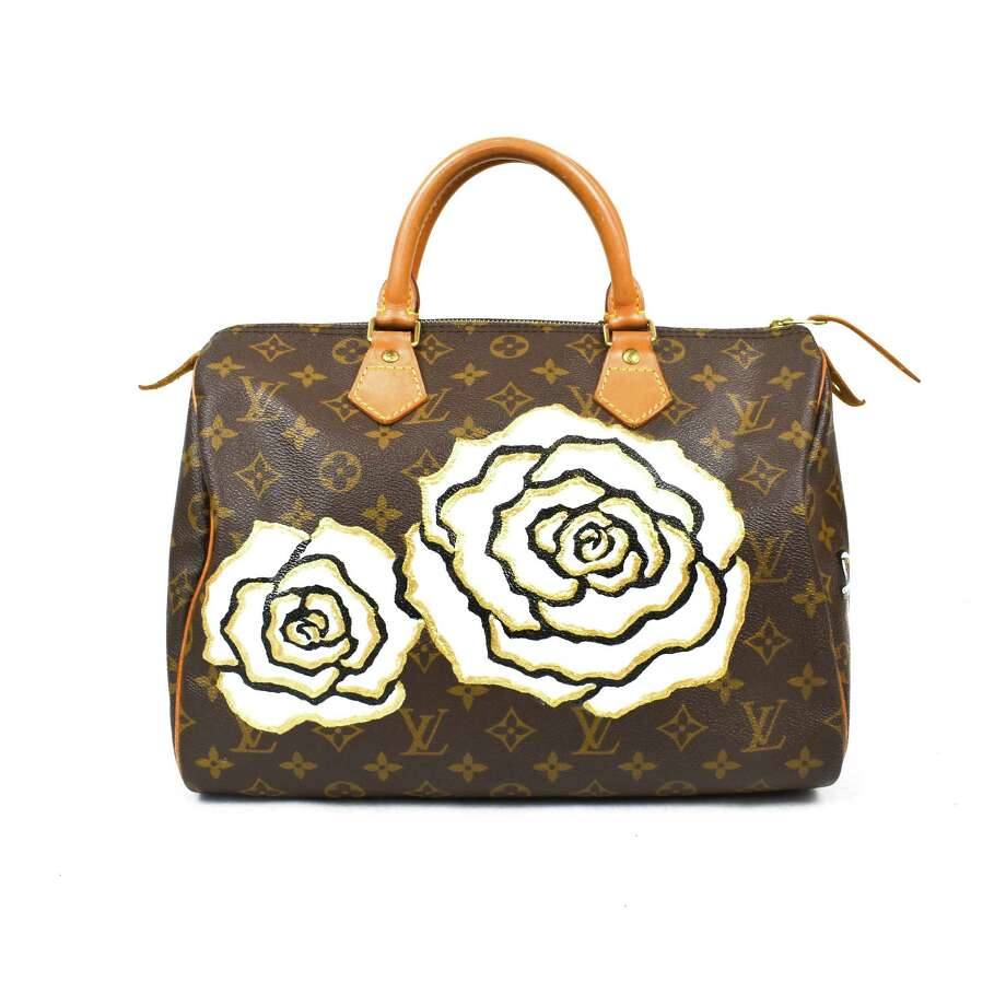 The Vintage Contessa recently unveiled feminine floral patterns by Houston artist Hanh Tran that are now available to add to its collection of vintage handbags and luggage. Photo: The Vintage Contessa