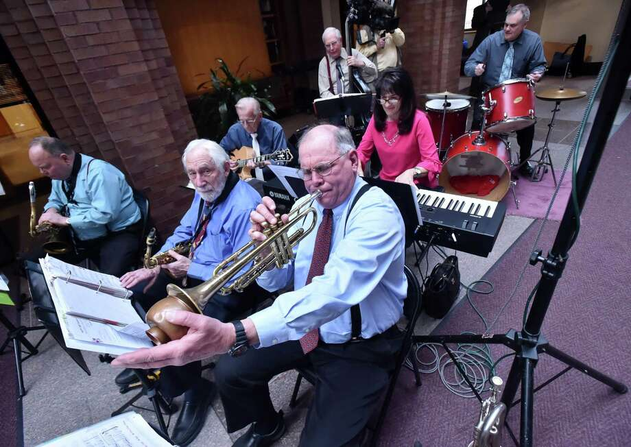 The Survivors Swing perform at New Haven's 380th birthday celebration at the first floor atrium at City Hall, Tuesday, April 24, 2018. Photo: Catherine Avalone / Hearst Connecticut Media / New Haven Register
