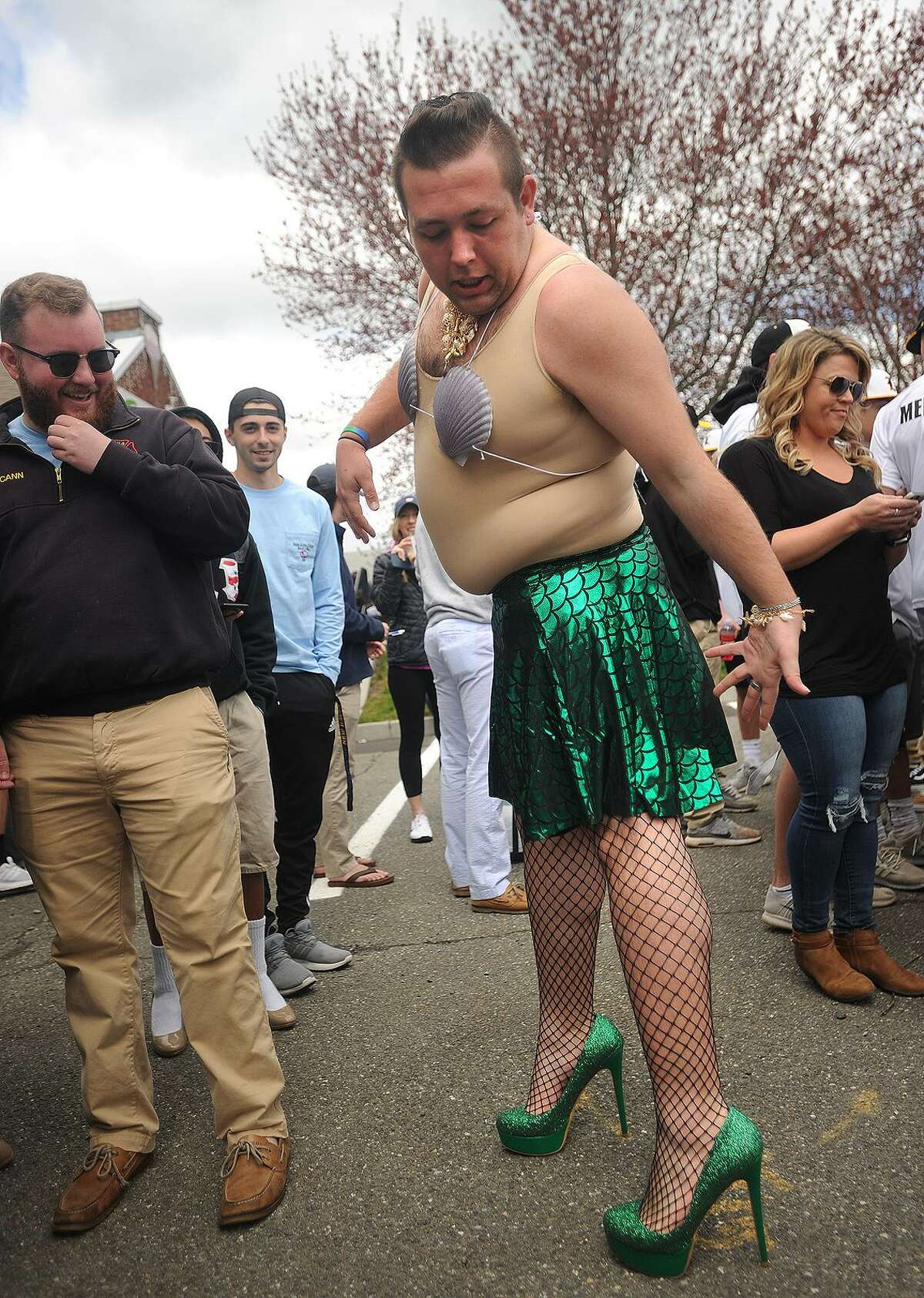 """University of New Haven student Jason Gundry dressed as a mermaid for the annual Walk a Mile in Her Shoes fundraiser in Milford, Conn. on Sunday, April 29, 2018. The walk benefits The Rape Crisis Center of Milford. Gundry won the """"Best in Shoe"""" award the previous year when he dressed as a Playboy bunny."""