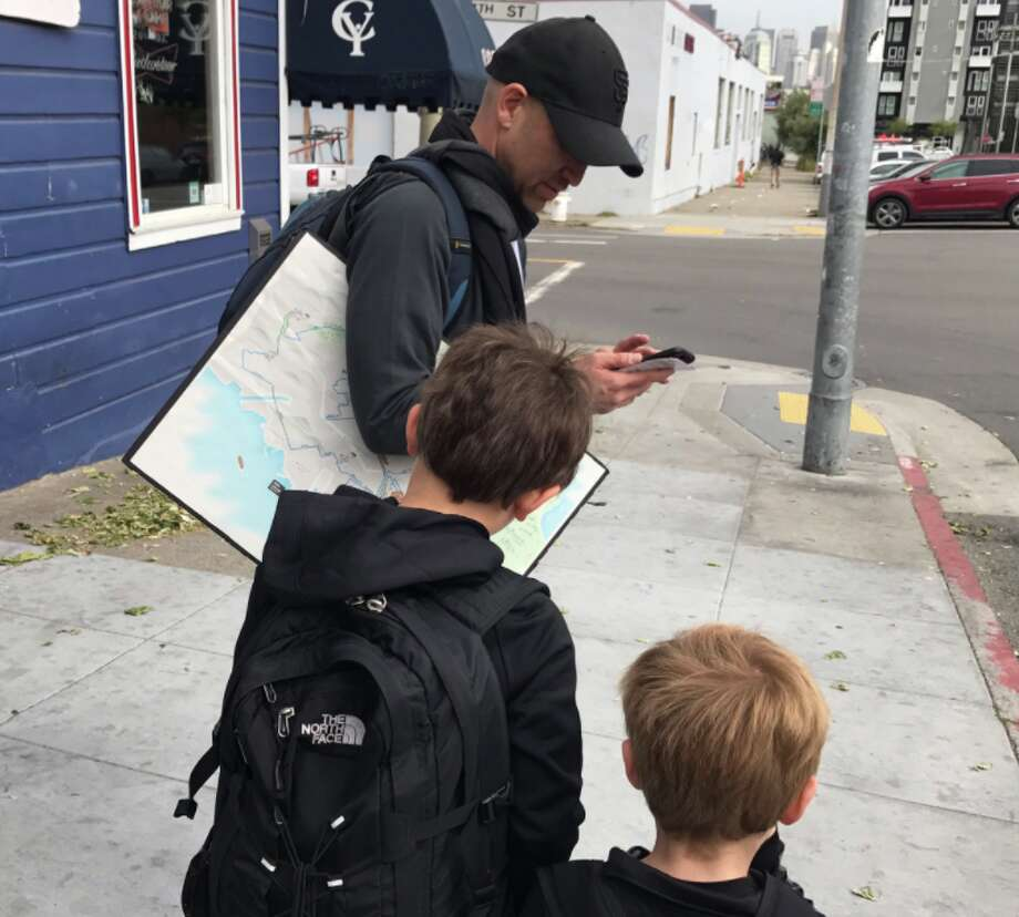 Heather Knight's sons help Peter Hartlaub with route planning during #TotalMuni2018.