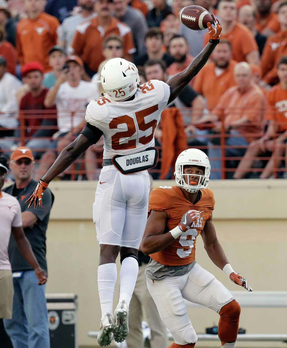 Texas defensive back Jarmarquis Durst (28) breaks up a pass intended for wide receiver Collin Johnson (9) during the team's Orange-White intrasquad spring college football game, Saturday, April 21, 2018, in Austin, Texas. (AP Photo/Eric Gay)