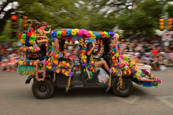 Flowers decorate one of the many vehicles during the Battle of Flowers Parade Friday as it makes its' way along Alamo St..