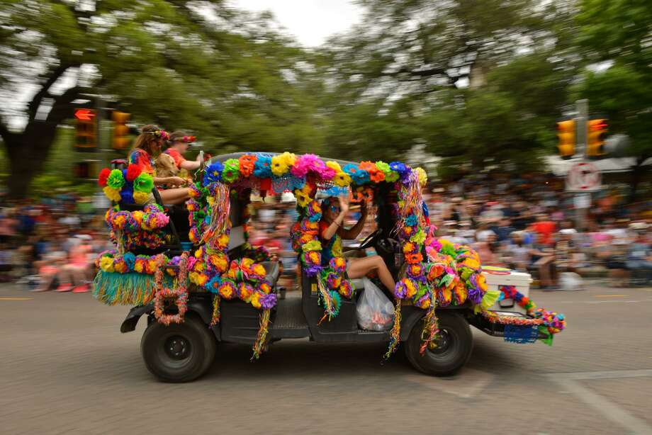 Flowers decorate one of the many vehicles during the Battle of Flowers Parade Friday as it makes its' way along Alamo St.. Photo: Robin Jerstad,  Freelance