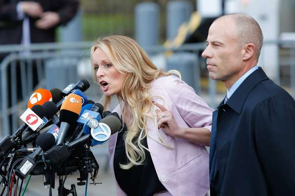 (FILES) In this file photo taken on April 16, 2018 adult-film actress Stephanie Clifford, also known as Stormy Daniels speaks outside US Federal Court with her lawyer Michael Avenatti (R) in Lower Manhattan, New York. Adult film star Stormy Daniels filed a defamation suit on April 30, 2018 against US President Donald Trump for a tweet in which he dismissed a composite sketch that Daniels says depicted a man who threatened her in 2011. / AFP PHOTO / EDUARDO MUNOZ ALVAREZEDUARDO MUNOZ ALVAREZ/AFP/Getty Images