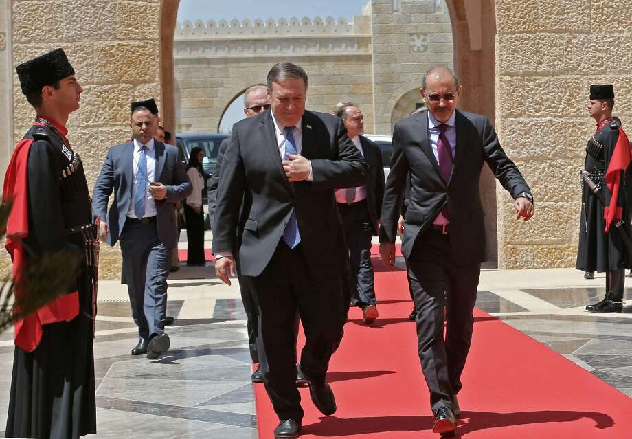 Jordans Foreign Minister Ayman Safadi (R) receives US Secretary of State Mike Pompeo (C-L) prior to meeting with the Jordanian King in Amman on April 30, 2018. / AFP PHOTO / POOL / KHALIL MAZRAAWIKHALIL MAZRAAWI/AFP/Getty Images Photo: KHALIL MAZRAAWI;Khalil Mazraawi / AFP / Getty Images
