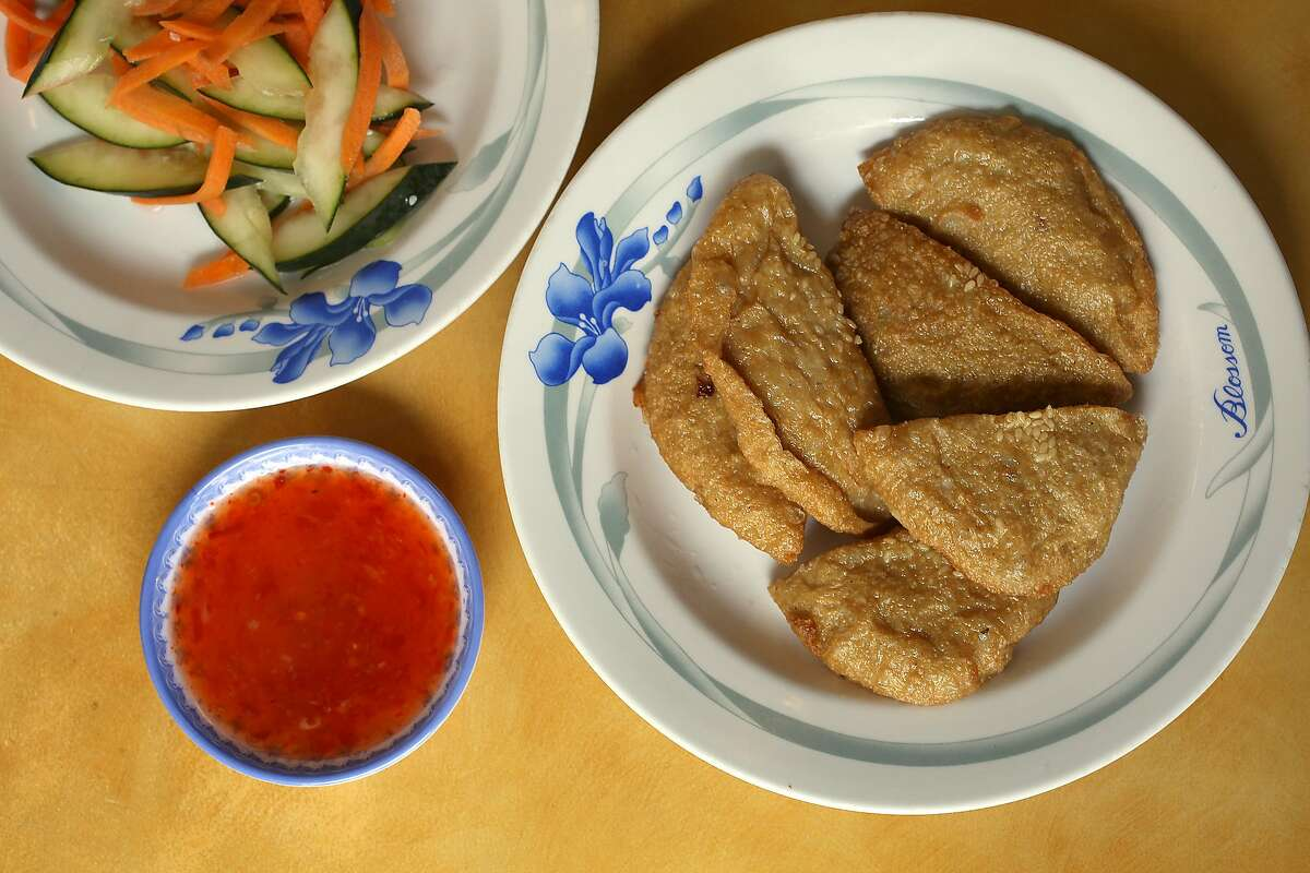 Cha Ca Chien (right)--golden fried fish cakes--with pickled vegetables (left) served at Hai Ky Mi Gia, a Vietnamese-Chinese restaurant on Friday, April 27, 2018, in San Francisco, Calif.