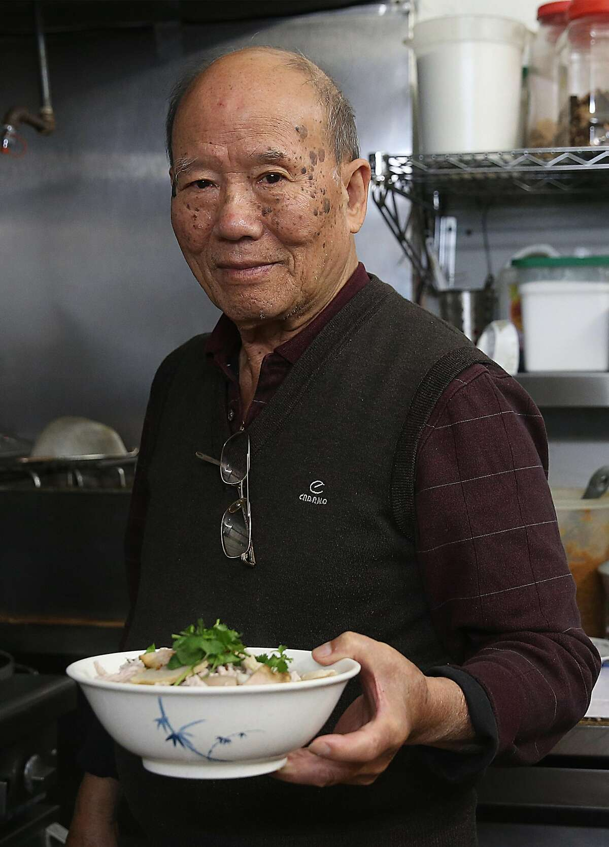 Tuan Hua, 80 years old, has been making noodle dishes at Hai Ky Mi Gia, a Vietnamese-Chinese restaurant, since April 1987 on Friday, April 27, 2018, in San Francisco, Calif.