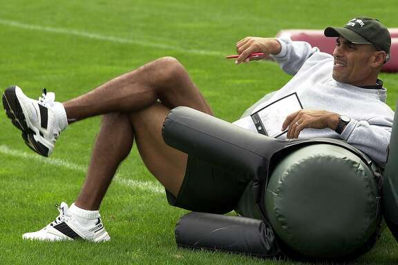 ** ADVANCE FOR WEEKEND EDITIONS AUG. 31-SEPT. 1 ** New York Jets head coach Herman Edwards watches his players during training camp at Mitchell Field in Hempstead, N.Y., Wed. Aug. 28, 2002. He smiles, he jokes around, he tells humorous stories. He has anecdotes for most situations. This is an NFL coach? Sure. It's Herman Edwards, who enters his second season in charge of the Jets. (AP Photo/Ed Betz)