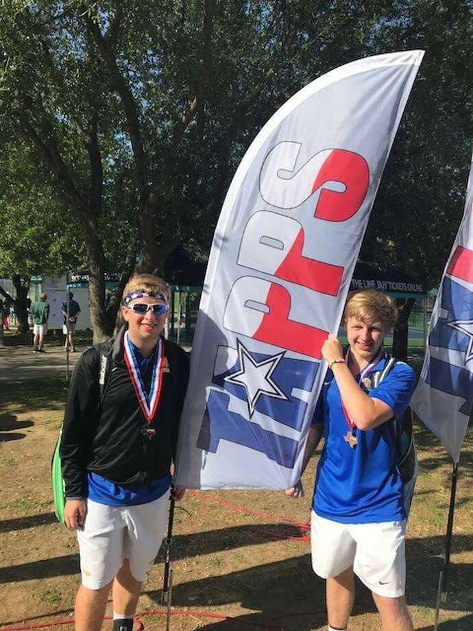 Kelly Catholic tennis players Bailey Braneff and David Parmer pose for a picture at the TAPPS State Tennis Championships in Waco. (Photo provided by Lisa Braneff)