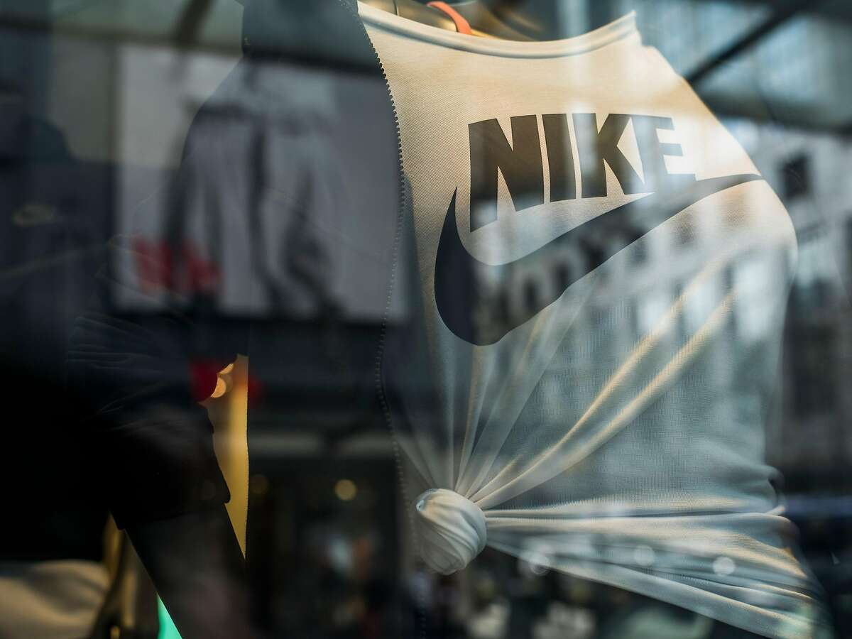 A clothing display at a Nike store in downtown Seattle, April 19, 2018. Nike is struggling to succeed in the women�s sportswear market as companies like Lululemon and even Old Navy attract customers and Nike grapples with reports of harassment and gender discrimination. (Kyle Johnson/The New York Times)