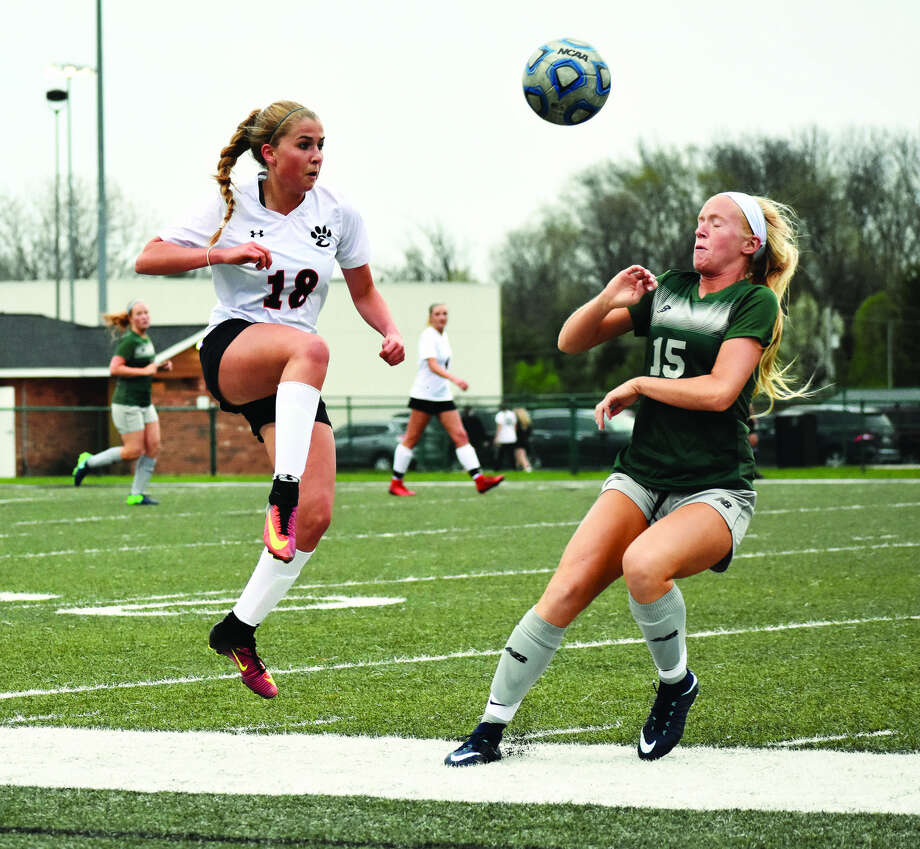Edwardsville's Zoe Ahlers goes up for a kick during a non-conference game against St. Joseph's Academy.