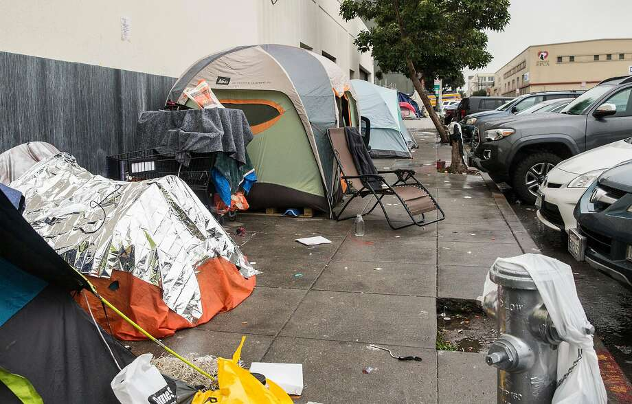 Multiple tents make up a homeless encampent near the corner of Florida and Treat streets Tuesday, March 20, 2018 in San Francisco, Calif. Photo: Jessica Christian / The Chronicle