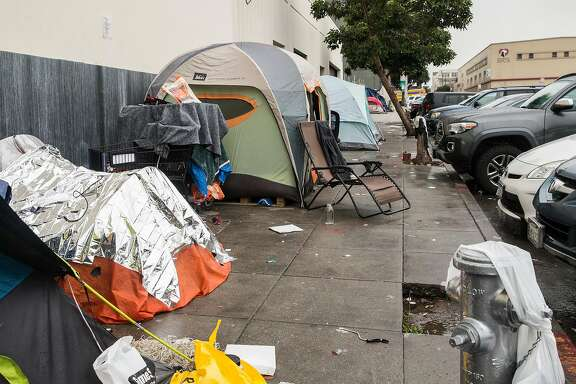 Multiple tents make up a homeless encampent near the corner of Florida and Treat streets Tuesday, March 20, 2018 in San Francisco, Calif.