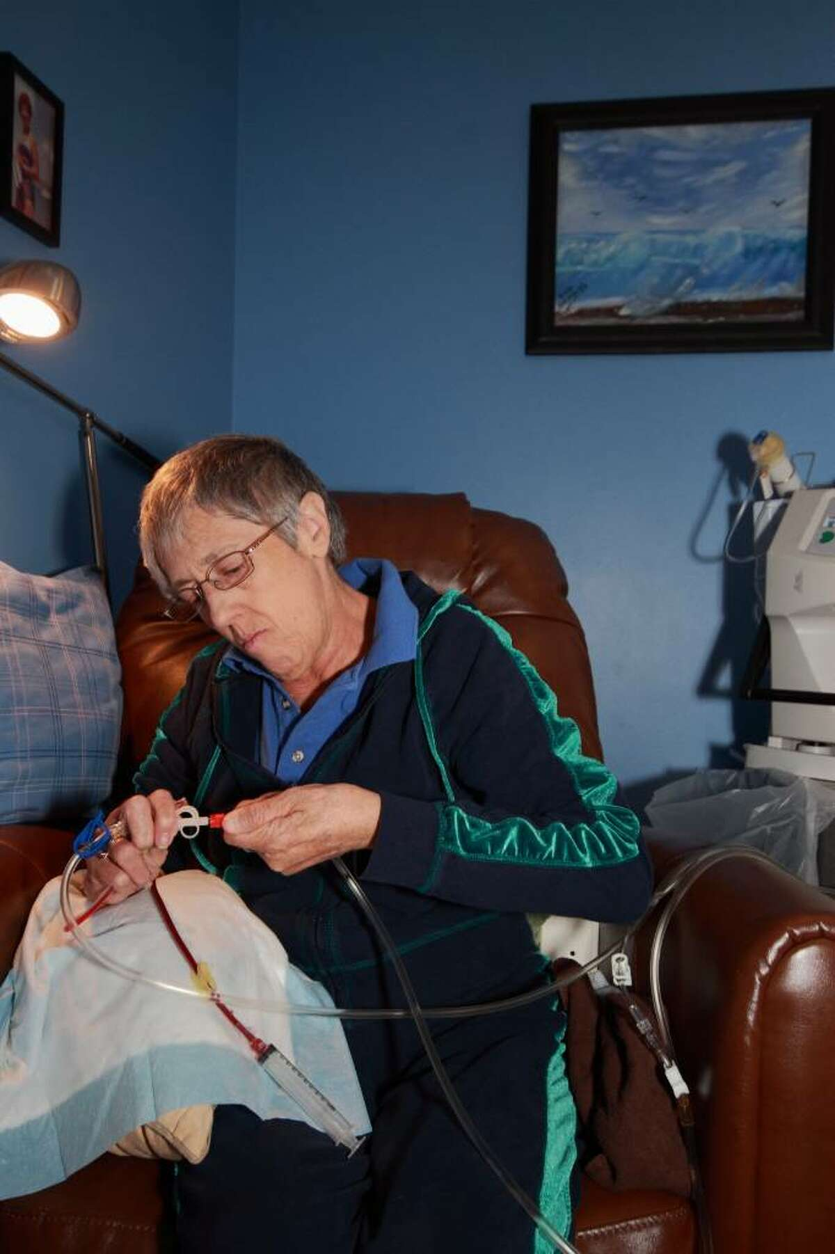 Susan Blais prepares for dialysis at home.