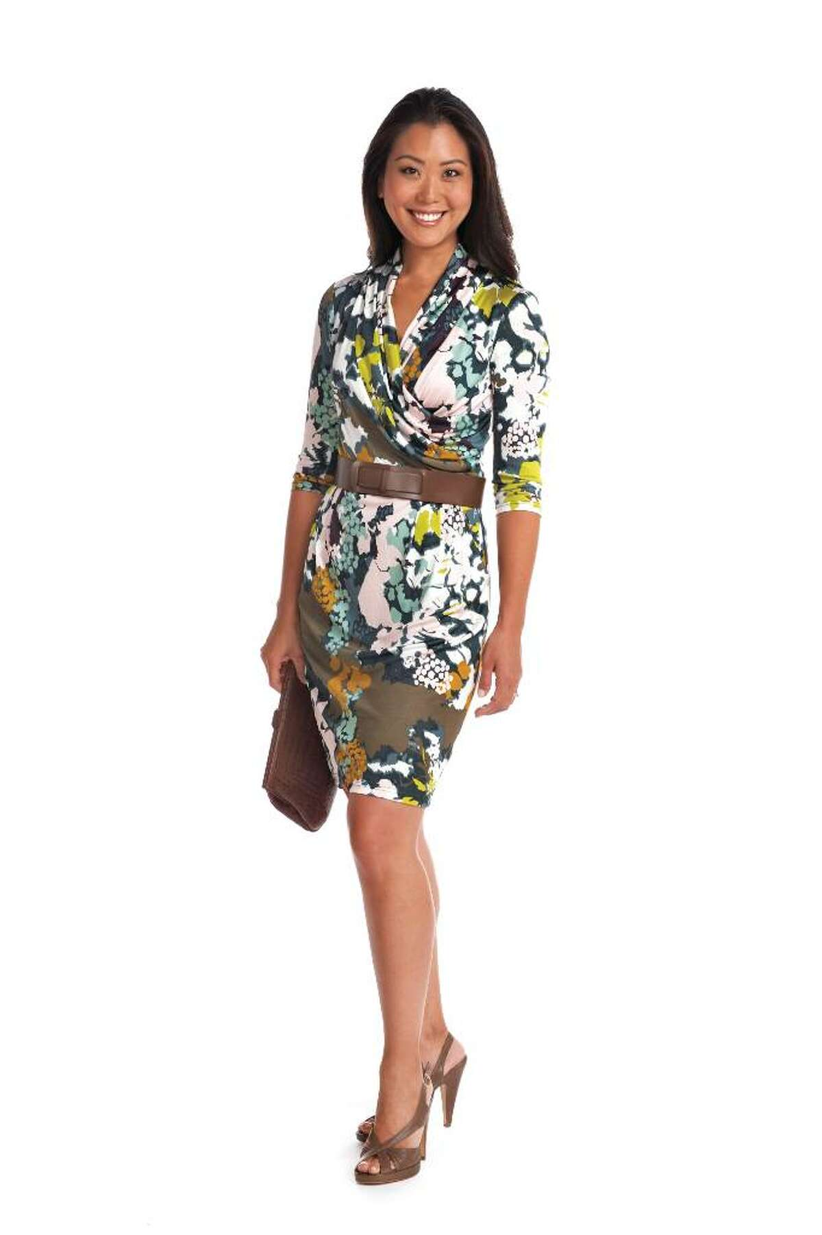 Susie is a makeup artist and green cosmetics entrepreneur whose whimsical style was getting in the way of her being taken seriously. This dress sends the message she?s a serious businesswoman and yet an individual. The print is not over the top, thanks to the brown and taupe accessories.