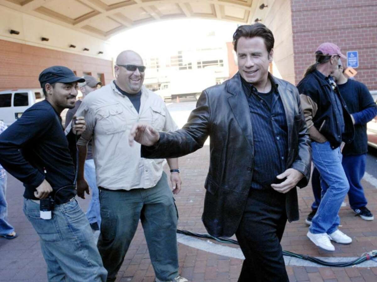 Actor, John Travolta, arrives at the Palace Theater in Stamford. Travolta was filming a scene for the movie