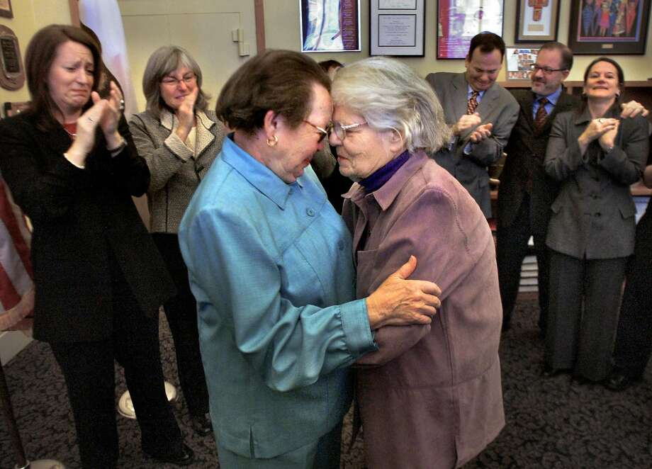 Phyllis Lyon, left, and Del Martin, who had been together for more than 50 years, embrace after their marriage at City Hall. Photo: Liz Mangelsdorf / The Chronicle 2004