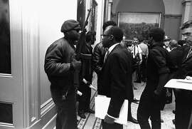 Assemblyman Willie L. Brown, Jr., D-San Francisco, center, talks to an armed member of the Black Panther Party in the corridor of the Capitol in Sacramento May 3, 1967.  They were protesting a bill before an Assembly committee restricting the carrying of loaded weapons in public.  (AP Photo/Walt Zeboski) Ran on: 10-11-2006 Surviving former members and associates of the Black Panther Party assemble on the steps of the Alameda County Superior Court in June for an Essence magazine cover story to mark the group's 40th anniversary. Ran on: 10-11-2006 Surviving former members and associates of the Black Panther Party assemble on the steps of the Alameda County Superior Court in June for an Essence magazine cover story to mark the group's 40th anniversary. Ran on: 10-11-2006
