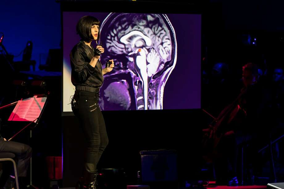 Dessa sings about heartbreak with a detail of a brain onscreen during a performance. Photo: Paul Phillips / Competitive Image
