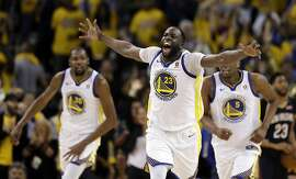 Golden State Warriors' Draymond Green celebrates after a basket against the New Orleans Pelicans during the first half in Game 1 of an NBA basketball second-round playoff series Saturday, April 28, 2018, in Oakland, Calif. (AP Photo/Marcio Jose Sanchez)