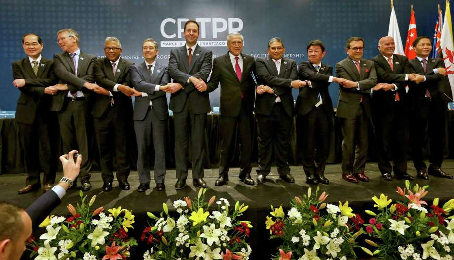 Leaders of nations on the Pacific Ocean pose for a pictures after the signing ceremony of the Comprehensive and Progressive Agreement for Trans-Pacific Partnership, CP TPP, in Santiago, Chile. Missing: the United States. President Trump pulled out of the deal shortly after taking office, then flirted with returning and then changed his mind. Photo: Esteban Felix /Associated Press / Copyright 2018 The Associated Press. All rights reserved.