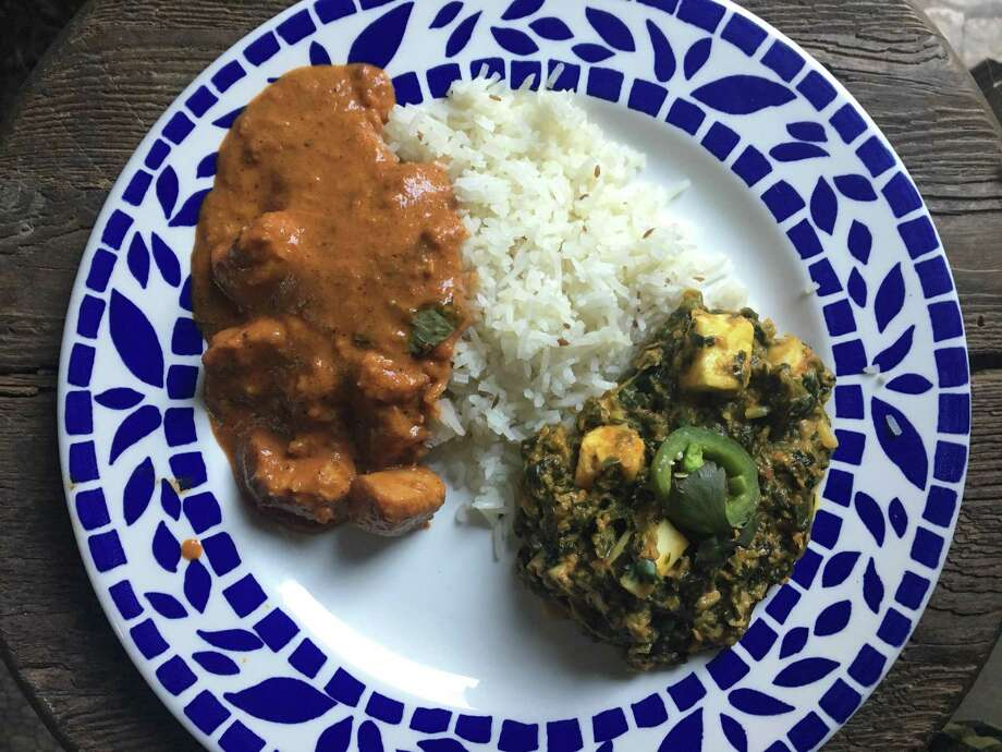 Butter chicken and sag paneer takeout from Tarka Indian Kitchen Photo: Alison Cook / Houston Chronicle