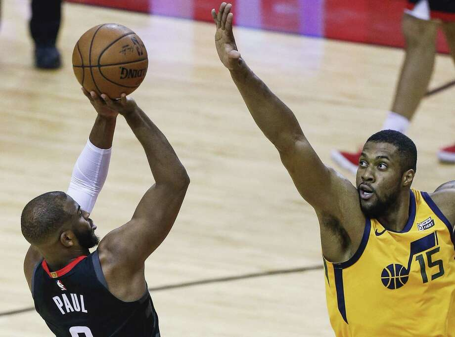 Rockets guard Chris Paul is still having to deal with Jazz forward Derrick Favors as he did in a seven-game series won by Utah over the Clippers last season. Photo: Michael Ciaglo, Houston Chronicle / Houston Chronicle / Michael Ciaglo