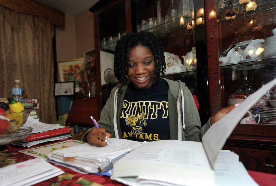 Brien McMahon High School Center for Global Studies student Marissa Howlett, who will be the first in her family to attend college, and her parents Raymond and Marvalyn Howlett at their home Wednesday, April 25, 2018, in Bridgeport, Conn. Photo: Erik Trautmann / Hearst Connecticut Media / Norwalk Hour