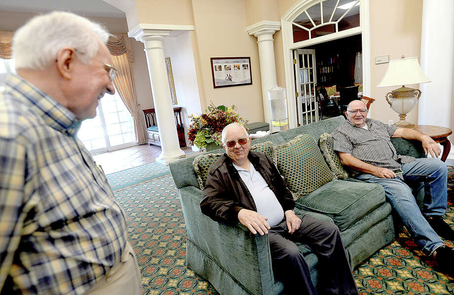 John Templeton (left) talks with Greg Cottington and Jim Givens as they gather in the lobby at Calder Woods and await their bus for the ROMEOS' monthly trip out to eat, which this month was at Catfish Cabin in Lumberton. The ROMEOS - Retired Old Men Eating Out - formed about 7 years ago and provides a social outlet for the men as well as an opportunity to get out in the community. Photo taken Tuesday, April 17, 2018 Kim Brent/The Enterprise Photo: Kim Brent / BEN