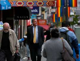 Supervisor Jeff Sheehy walks on Castro Street in San Francisco, Calif. on Wednesday, April 25, 2018 while campaigning to retain his District 8 seat on the board.