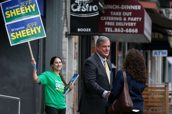 Supervisor Jeff Sheehy meets with a voter on Castro Street in San Francisco, Calif. on Wednesday, April 25, 2018 while campaigning with Holly Burke (left) to retain his District 8 seat on the board.