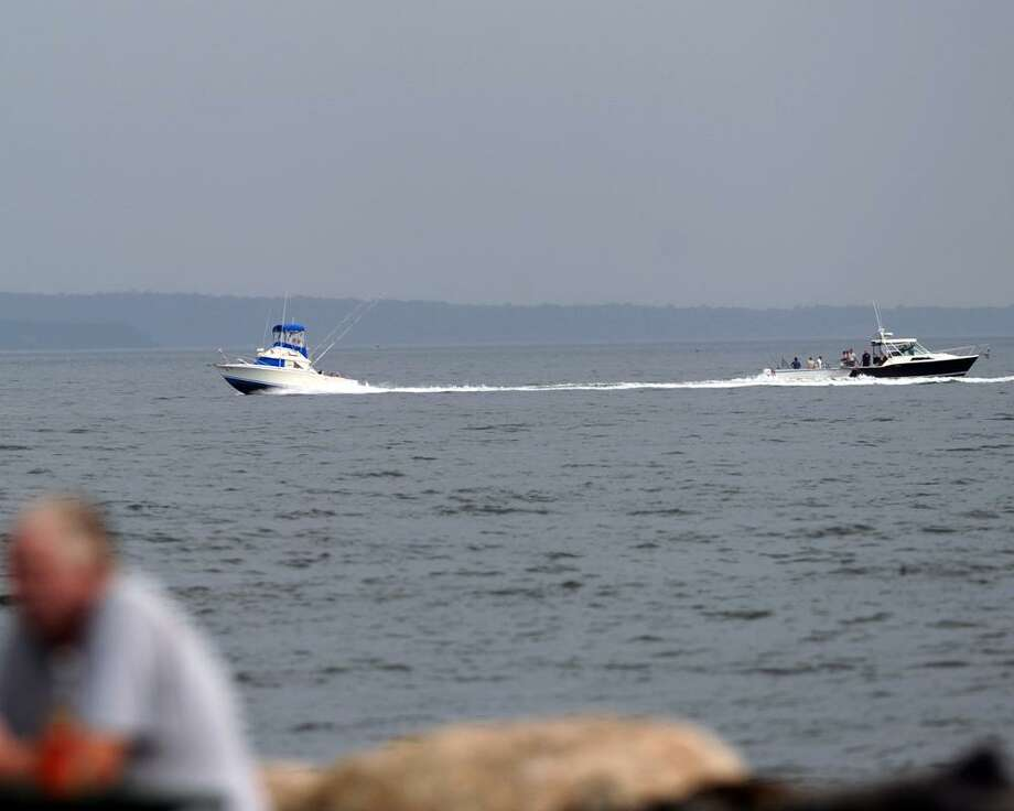 Boats in Long Island Sound off the coast of Greenwich Point, Wednesday evening, July 3, 2013. Photo: Bob Luckey / Bob Luckey / Greenwich Time