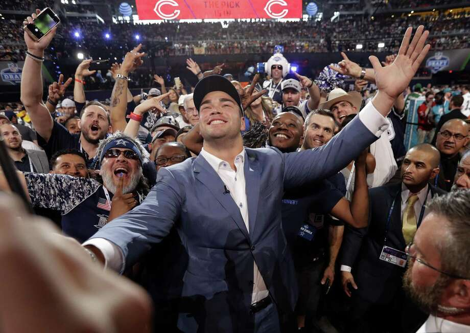 Texas' Connor Williams poses for a photo with Dallas Cowboys fans after being selected by the team during the second round of the NFL football draft Friday, April 27, 2018, in Arlington, Texas. (AP Photo/Eric Gay) Photo: Eric Gay, STF / AP / Copyright 2018 The Associated Press. All rights reserved.