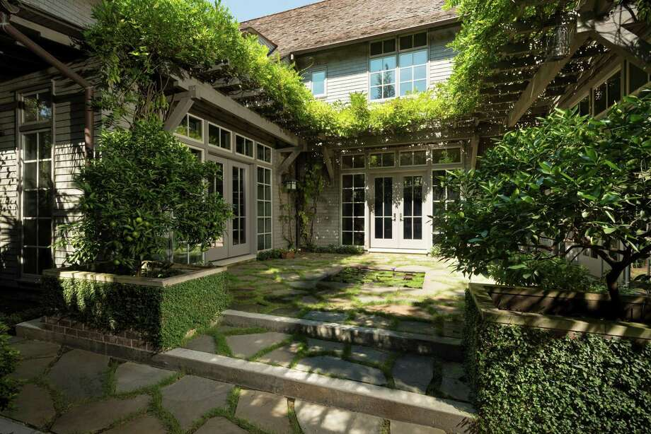 """The River Oaks home of Susie and Sanford Criner has views of greenspace from every room. It's one of 19 spaces featured in architect Jay Baker's new book, """"Making Things."""" Photo: Frank White / Frank White"""