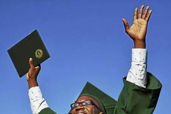 Antoine Wilkins celebrates upon the receipt of his diploma at Hamden High School class of 2016 graduation, Tuesday, June 14, 2016, at the Joe Bruno Field. (Catherine Avalone/New Haven Register) ¬  ¬