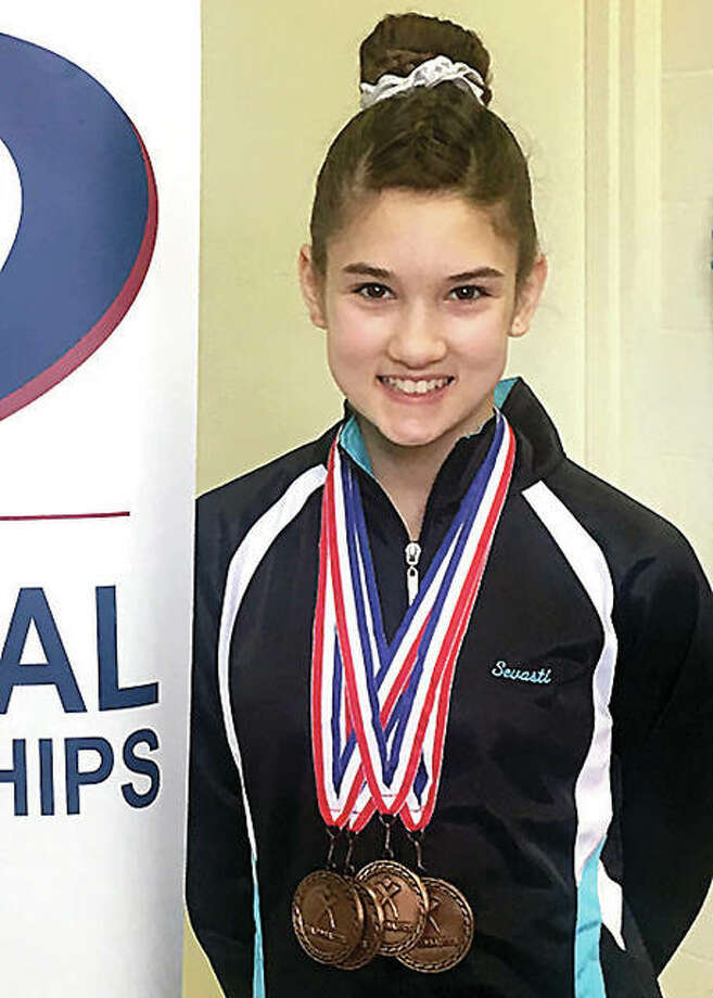 Sevasti Binolis, 13, of Mid Illinois Gymmastics in Godfrey, displays the medals she won at the recent Region 5 Gymnastics Championships in Ohio. Photo:       Mid Illinois Gymnastics