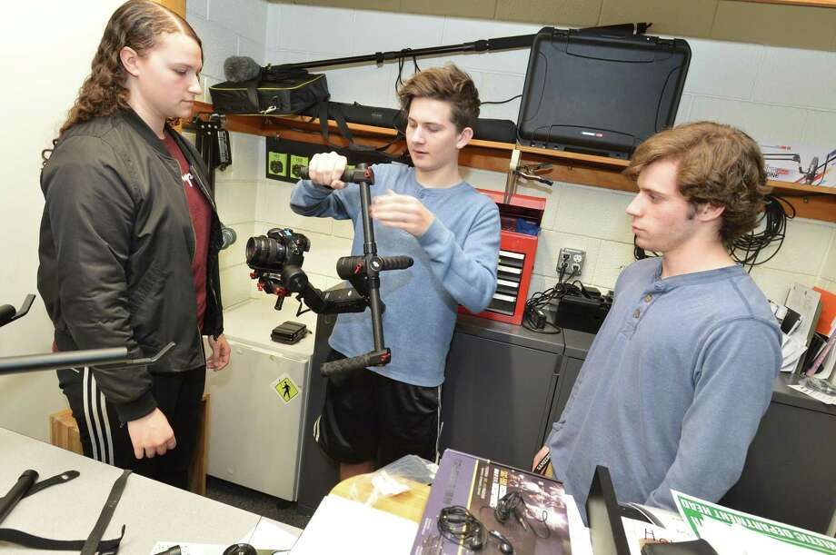 Talon Goulart and Sean Donaher get a tutorial from Sarah Arena on the Ronin gimbal mount used to steady and pan horizontaly with the camera during Norwalk High School's Digital Media Academy class on Monday April 30, 2018 in Norwalk Conn Photo: Alex Von Kleydorff / Hearst Connecticut Media / Norwalk Hour