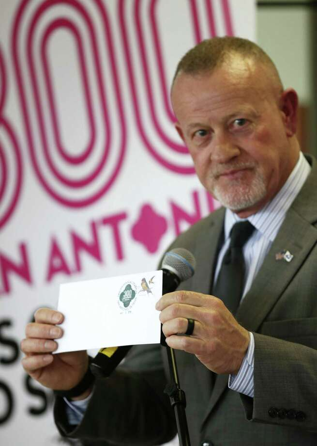 San Antonio Postmaster Robert D. Carr, Jr., holds up an envelope with the San Antonio Tricentennial Cancellation Postmark during a press conference at the Arsenal Post Office, Monday, April 30, 2018. The postmark will only be available through the month of May at the Arsenal Post Office located at 1140 S. Laredo St. Photo: JERRY LARA /San Antonio Express-News / San Antonio Express-News