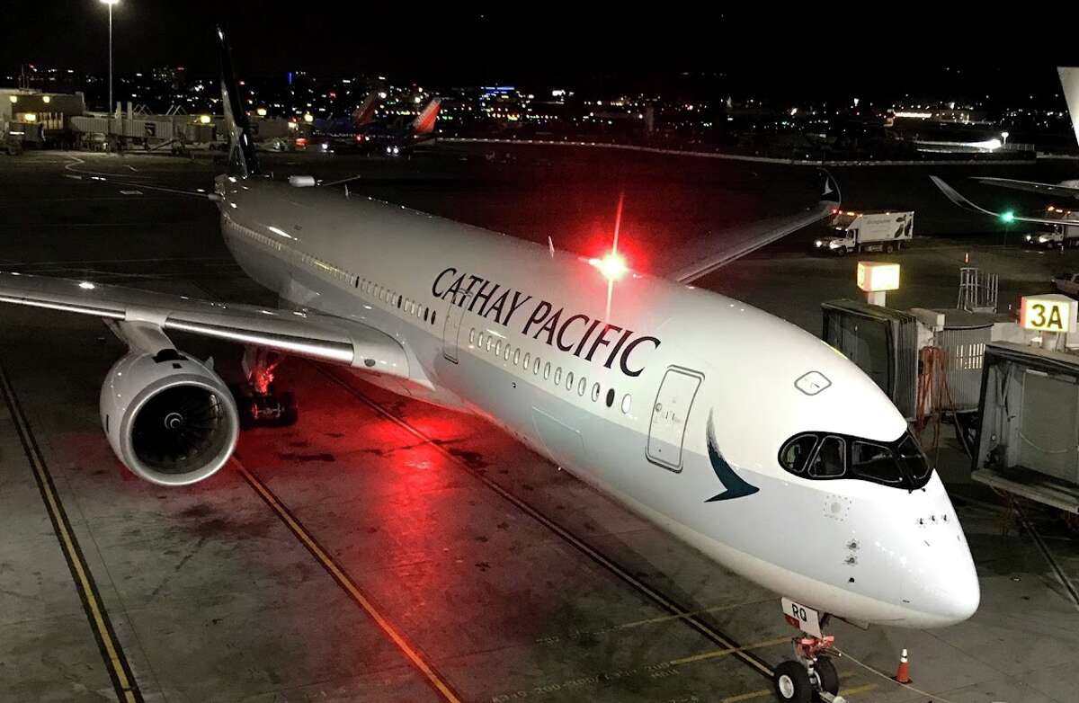 Cathay Pacific A350 departing at midnight from SFO for Hong Kong- see the raccoon eyes and rounded outer edge of cockpit windows?