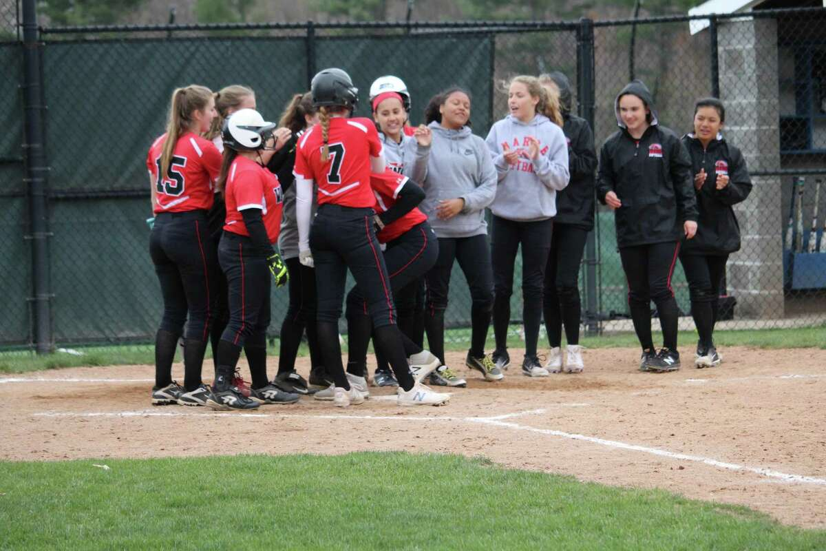 Fairfield Warde's Olivia Vadas crosses the plate after hitting her second homerun of the game during an FCIAC softball game on Monday between Fairfield Warde and Darien at Darien High School in Darien, Conn. Warde defeated Darien 6-4.