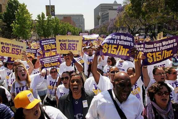 LOS ANGELES, CA - APRIL 14: More than a thousand L.A. County homecare workers march downtown to call for a hike in the minimum wage to $15 per hour on Tuesday, April 14, 2015 in Los Angeles, California. Representatives of organized labor, including the Service Employees International Union, claim that the current hourly wage of $9.95 is not enough for workers to support their families and keeps many people mired in poverty.  (Photo by Luis Sinco/Los Angeles Times via Getty Images)