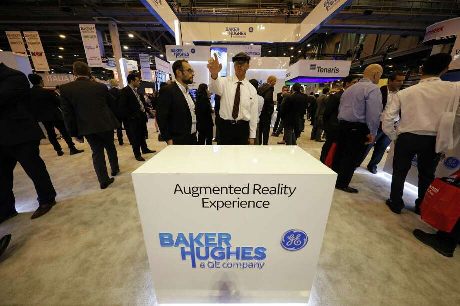 An attendee uses augmented reality glasses at the Baker Hughes, a General Electric (GE) Company, booth during the 2018 Offshore Technology Conference (OTC) in Houston, Texas, U.S., on Monday, April 30, 2018. The OTC gathers energy professionals to exchange ideas and opinions to advance scientific and technical knowledge for offshore resources. Photographer: Aaron M. Sprecher/Bloomberg Photo: Aaron M. Sprecher / Bloomberg / © 2018 Bloomberg Finance LP