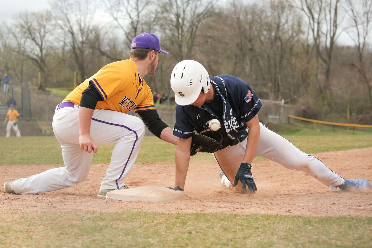 Staples' Max Popken dives back to first as Westhill's Zac Ferinstein loses control of the ball during the Wreckers 9-0 victory over Westhill High School in Stamford, Conn. on Monday, April 30, 2018.