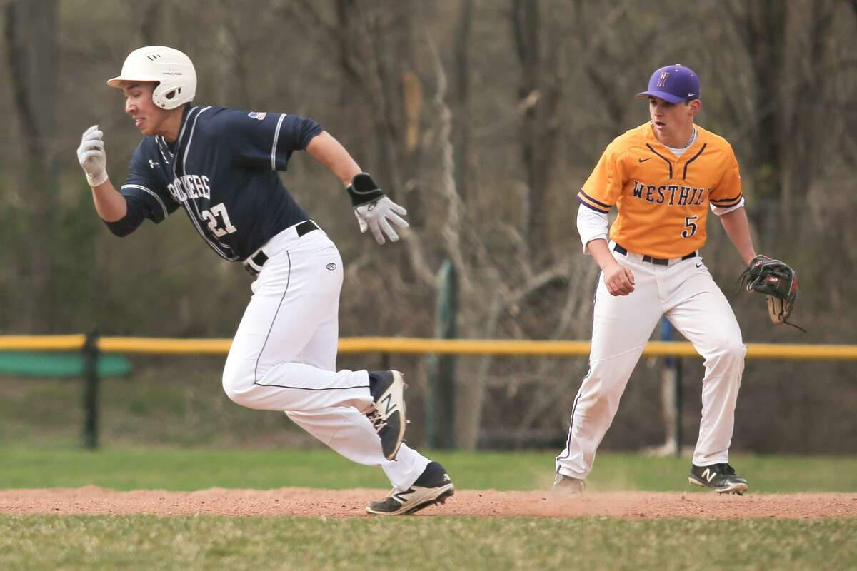 Staples' Chad Knight runs to third base during The Wreckers 9-0 victory over Westhill High School in Stamford, Conn. on Monday, April 30, 2018.