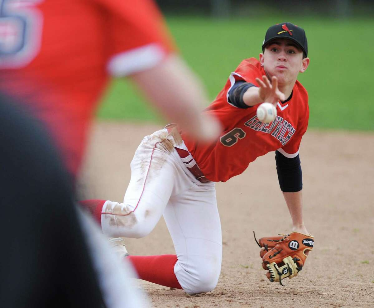 Greenwich second baseman Stephen Bennett flips to first for an out against Greenwich on Monday.